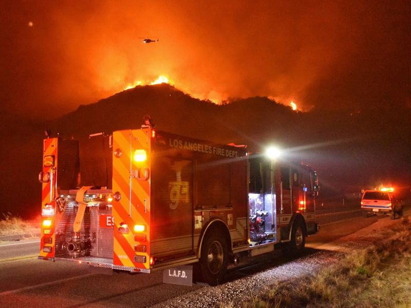 A Los Angeles Fire Department Engine is seen on Highway 154 during operations to battle flames in the nearby hillside, Santa Barbara, California.