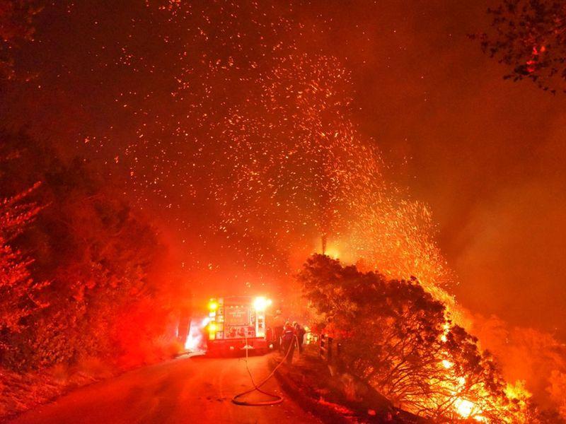 Firefighters battle flames off Highway 154 north of Santa Barbara, California.