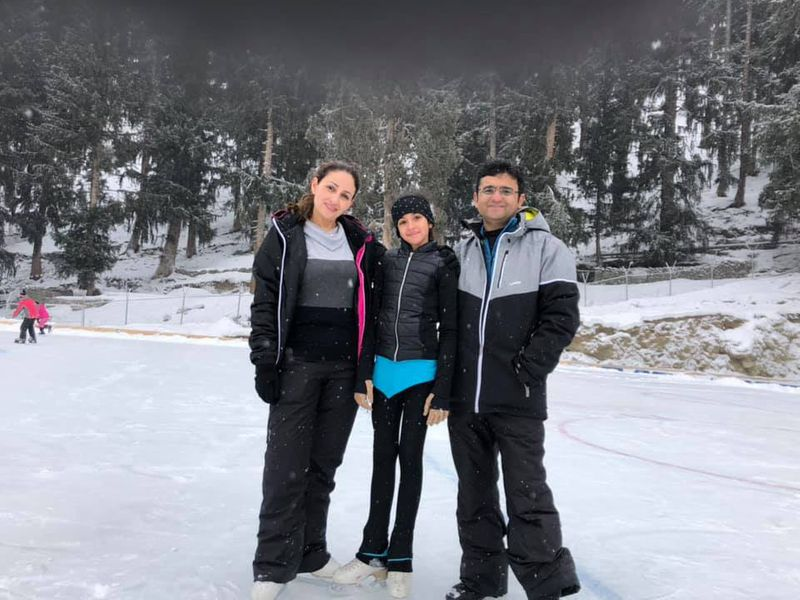 WPK 191128  Mallak Faisal Zafar, Pakistan's first figure skater, with her parents. Image Credit - Facebook page-1574937075840