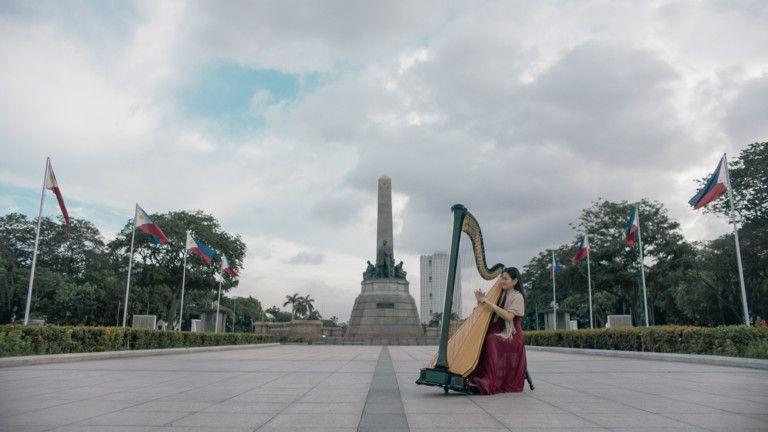 Expo 2020 - National Day Video 2019 - Filipina harpist Madeline Jane Banta in Rizal Park in Manila-1575184715474