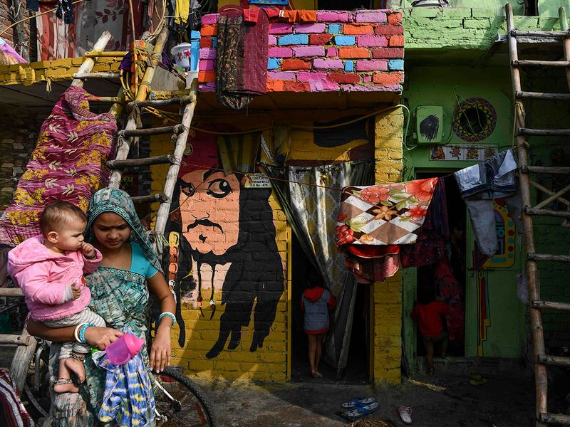 Murals have been painted by 15 to 20 artists from 'Delhi Art Street' group to reflect nature and the life of inhabitants on the walls of houses at a slum in New Delhi.
