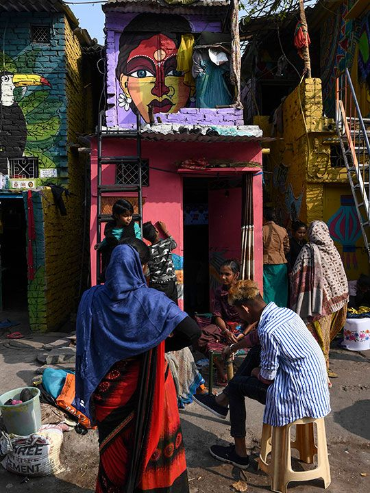 Murals have been painted by 15 to 20 artists from 'Delhi Art Street' group to reflect nature and the life of inhabitants on the walls of houses at a slum in New Delhi