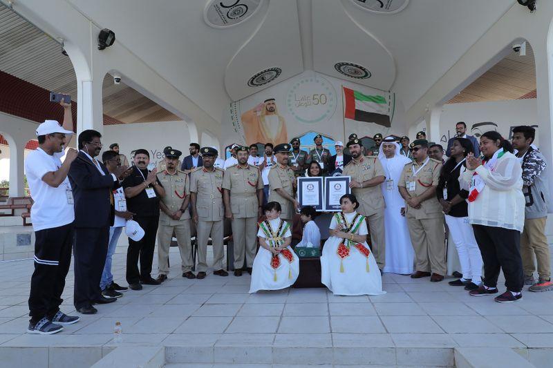 NAT 191205 UAE FLAG POLICE-1575549873577