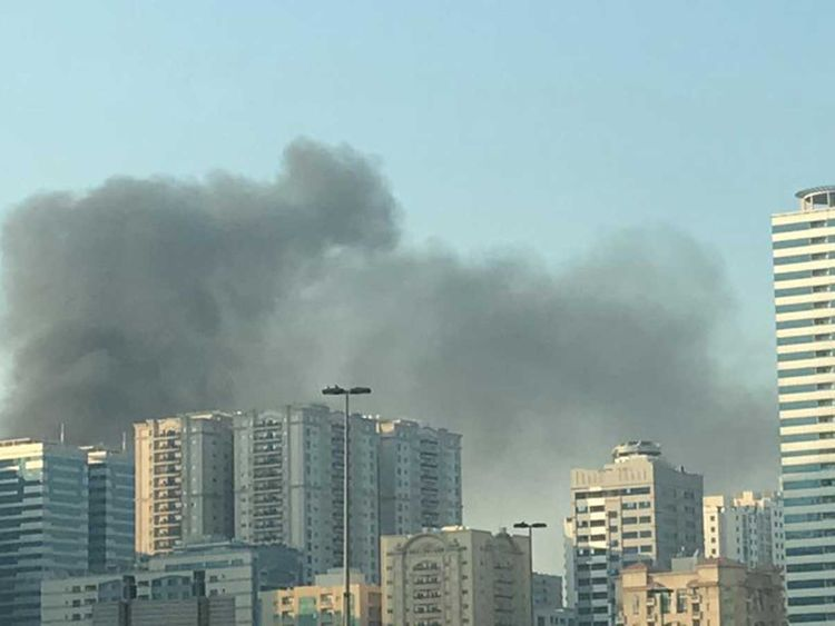 Smoke rising from a parking lot in Al Nahda