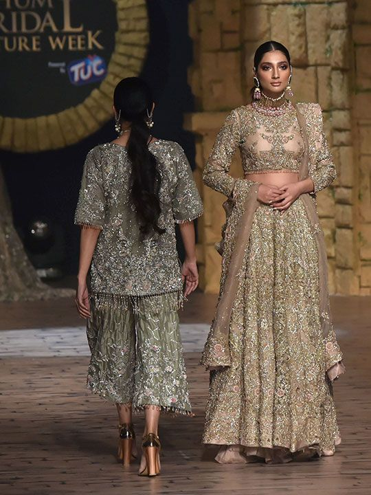 Models present creations by the Samsara Couture House during the first day of the 17th edition of Pantene Hum Bridal Couture Week in Lahore.