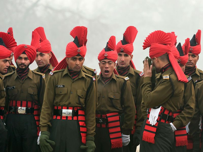 Newly recruited Indian army soldiers from the Jammu and Kashmir Light Infantry (JAKLI) wait before  a passing out parade at JAKLI army headquarter in Srinagar.