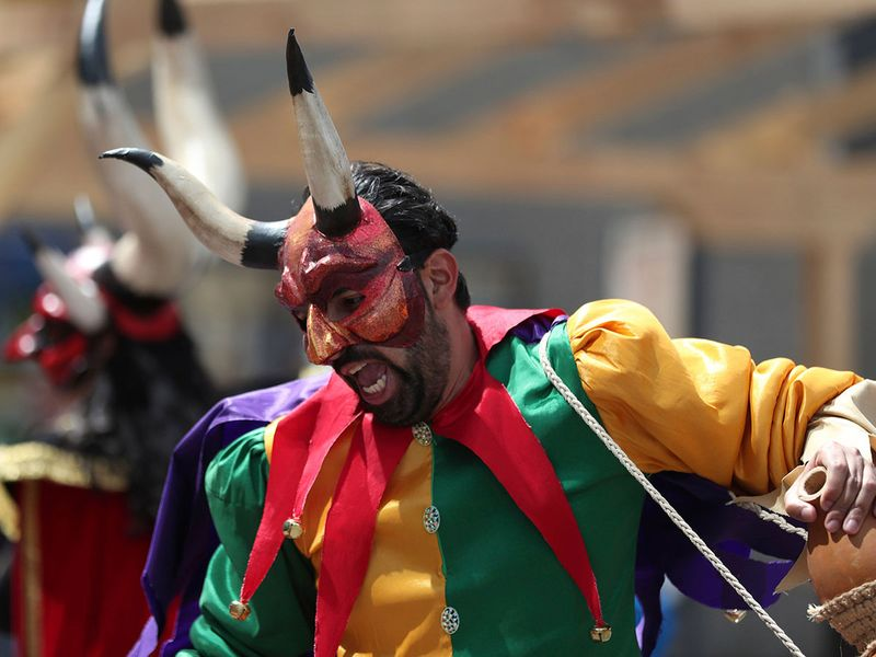 A dancer of the Carnival of Riosucio, also known as the Carnival of the Devil, performs
