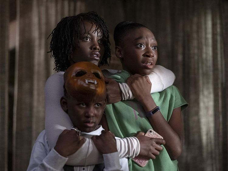 Lupita Nyong'o, Evan Alex, and Shahadi Wright Joseph in Us (2019)-1576049527524