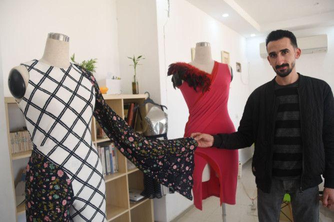 REG 191212  RUBBISH omari with his dresses-1576224265507