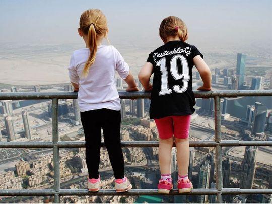 Children on balcony social media parents story