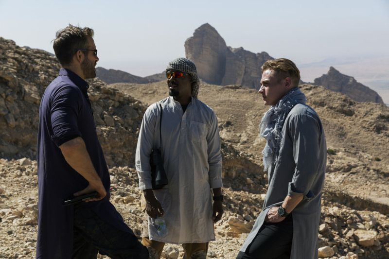 RYAN REYNOLDS [ONE],  BEN HARDY [FOUR], and COREY HAWKINS [SEVEN] during filming in Abu Dhabi-1576417823303