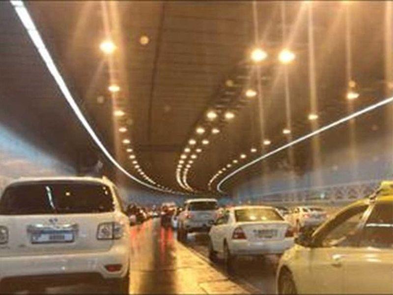 Airport tunnel rain traffic