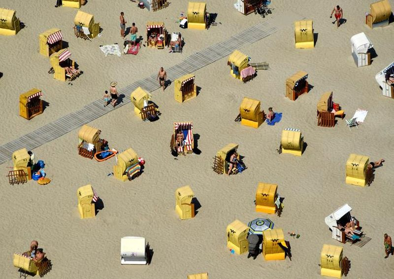 People enjoy sunbathing at a beach by the Baltic Sea in Travemuende, Germany, June 30, 2019.