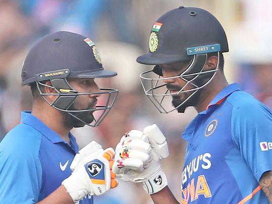 Rohit Sharma, left, interacts with batting partner KL Rahul