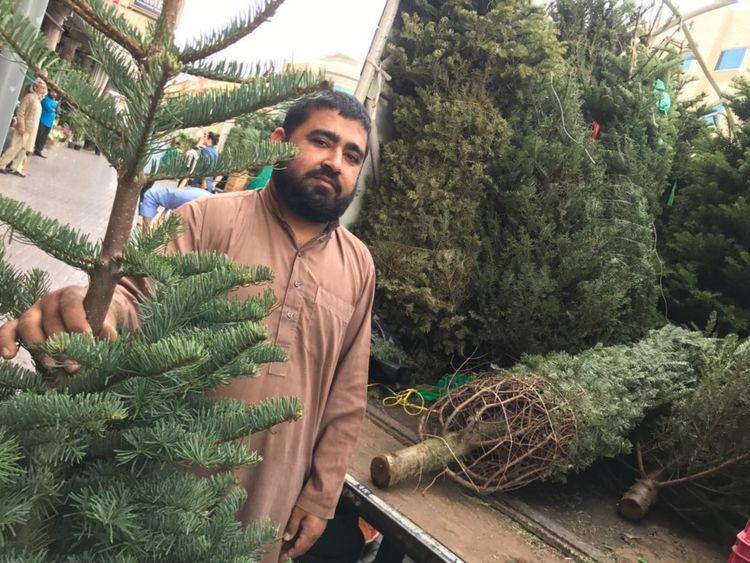 NAT 191219 Christmas tree sellers in Satwa1-1576752558124