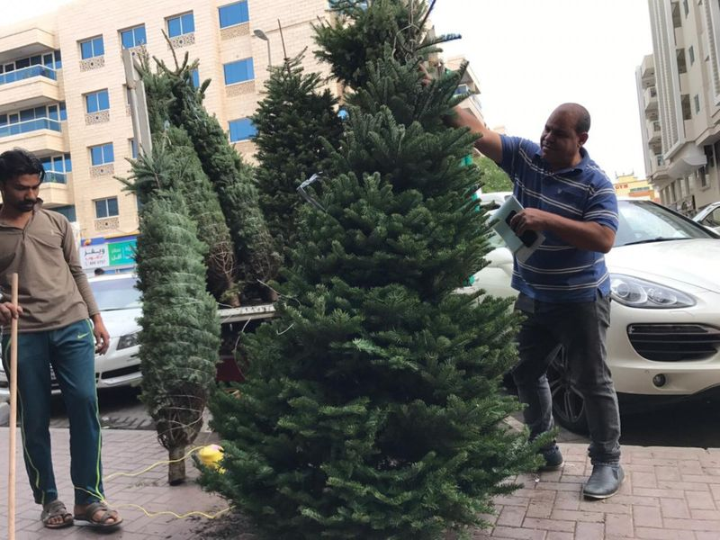 NAT 191219 Christmas tree sellers in Satwa2-1576752559933