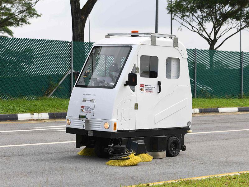 an autonomous buggy (L) and an autonomous road sweeper (R)