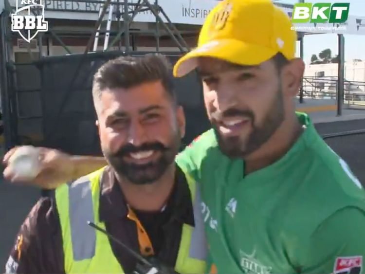 Haris Rauf (right) is seen with the Indian security guard