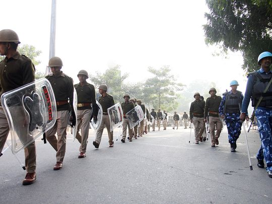 Police and Rapid Action Force conduct a flag march