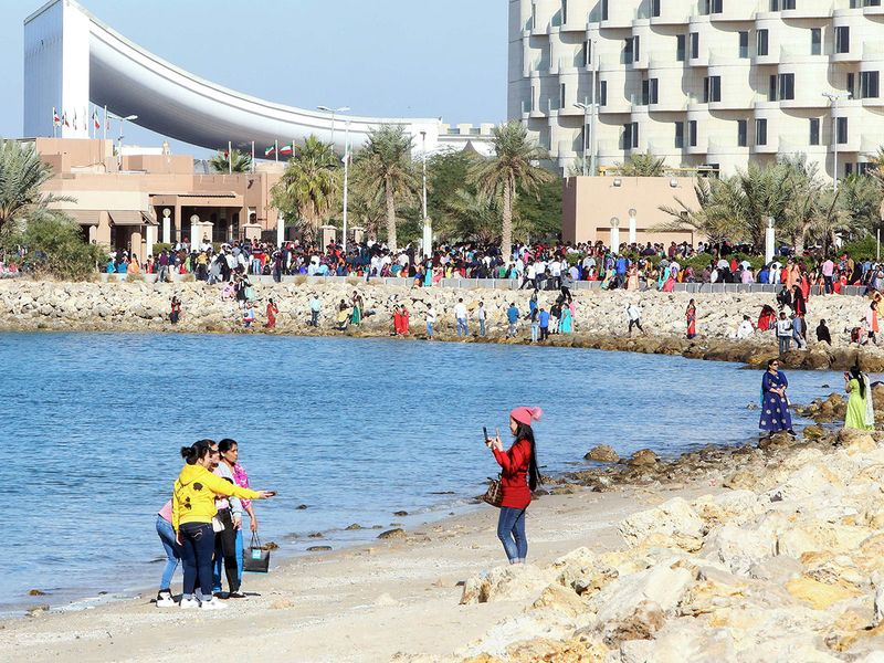 Christians spend their Christmas Day on the beach in Kuwait City