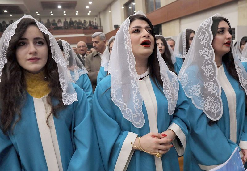 Iraqi Christians attend a Christmas Eve service at the Church of Um al-Noor