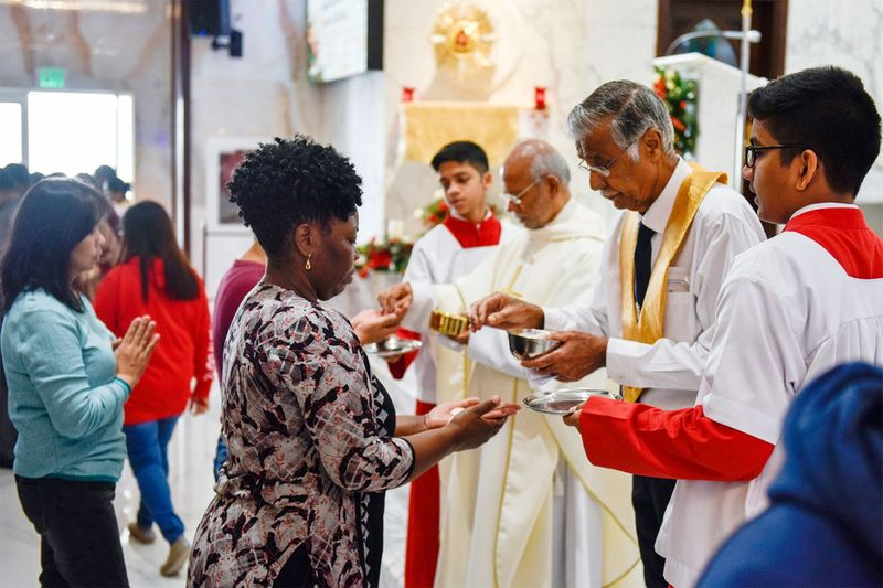 The members of Christian community attend the Christmas Mass at St. Michael's Catholic Church in Sharjah.
