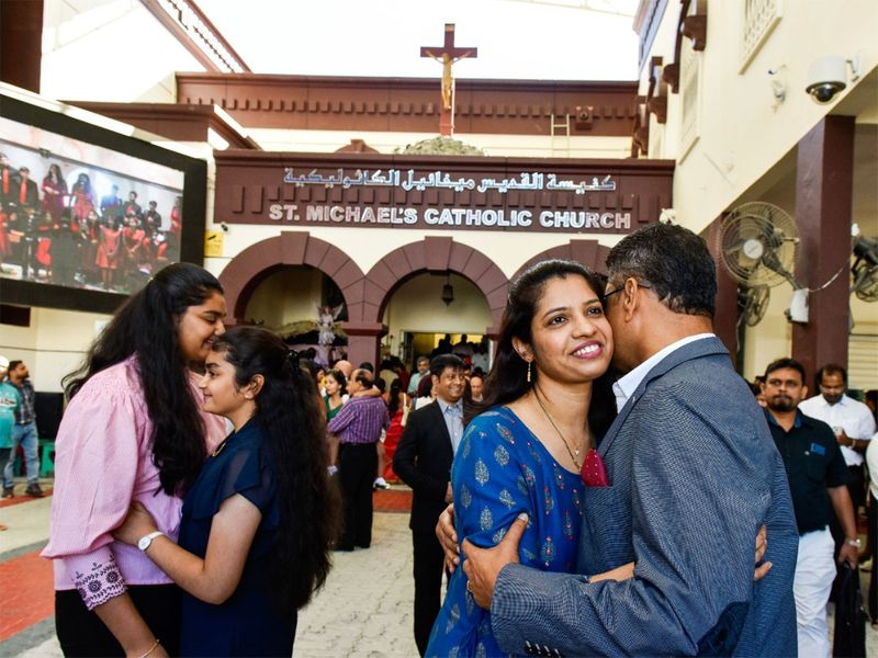 Worshippers greet each other after the Christmas Mass at St. Michael's Catholic Church in Sharjah.