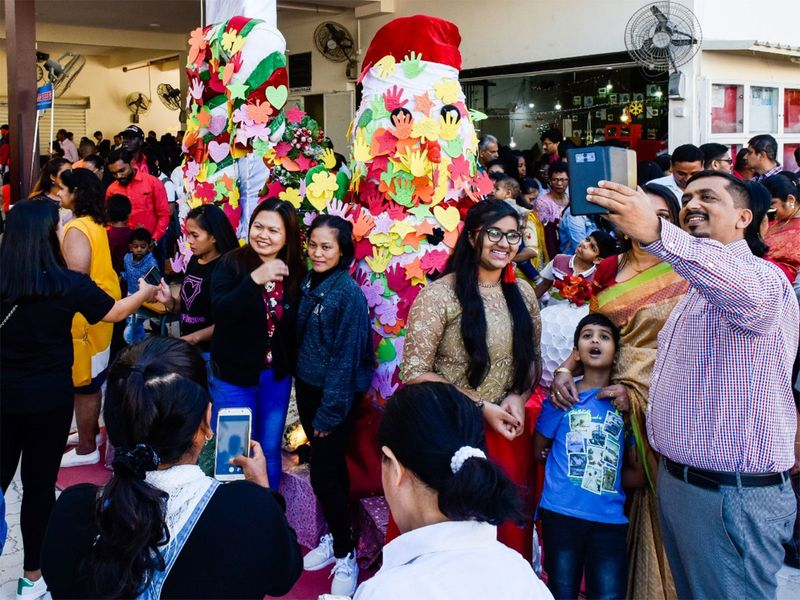 Worshippers take photos after the Christmas Mass at St. Michael's Catholic Church in Sharjah.