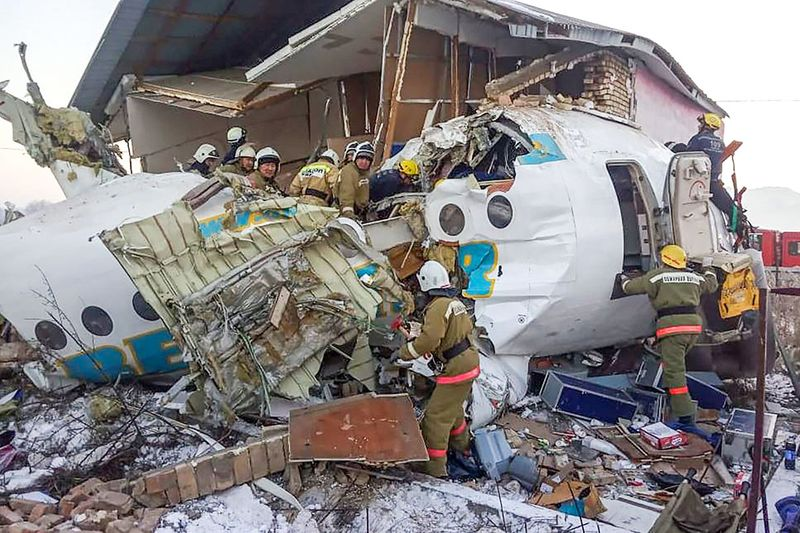 Rescue workers working at the site of a passenger plane crash outside Almaty