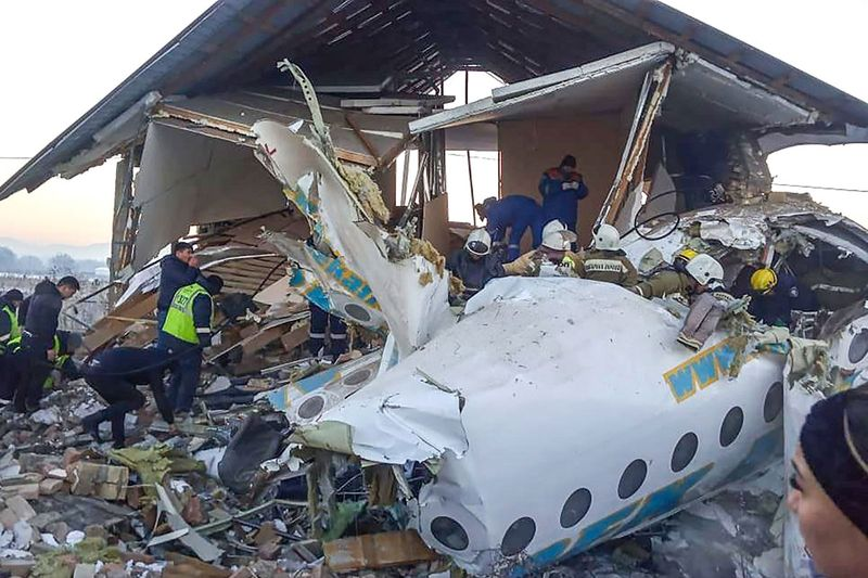 Rescuers working at the site of a passenger plane crash outside Almaty.