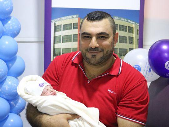 NAT 200101 Baby Joseph with Father Romeo Sheha 2 Bareen International Hospital-1577871330091
