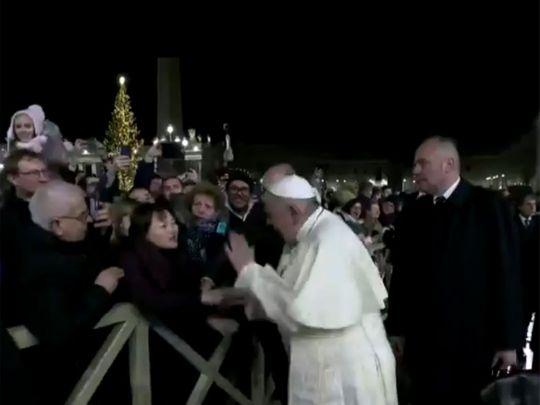 Pope slaps devotee