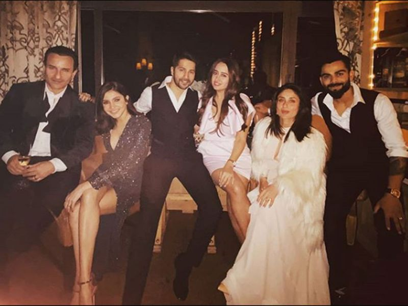 Anushka Sharma poses with Saif Ali Khan while hubby Virat Kohli poses with Kareena. along with the Varun Dhawan and Natasha Dalal.