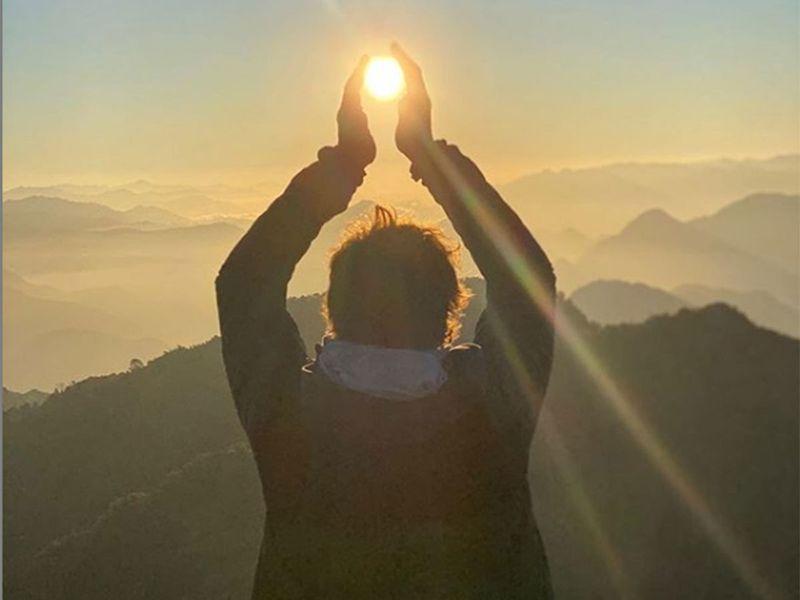 Butler shared a photograph of himself doing the Suryanamaskar at the Himalayan hills of Rishikesh.