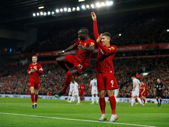 Sadio Mane and Roberto Firmino celebrate the win over Sheffield.