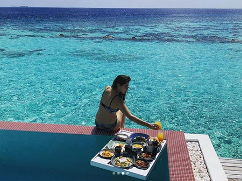 The actress enjoys a lavish floating breakfast in the pool.