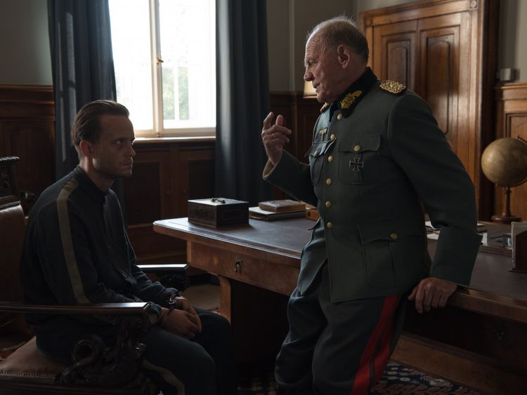 Bruno Ganz and August Diehl in A Hidden Life (2019)-1578469709306