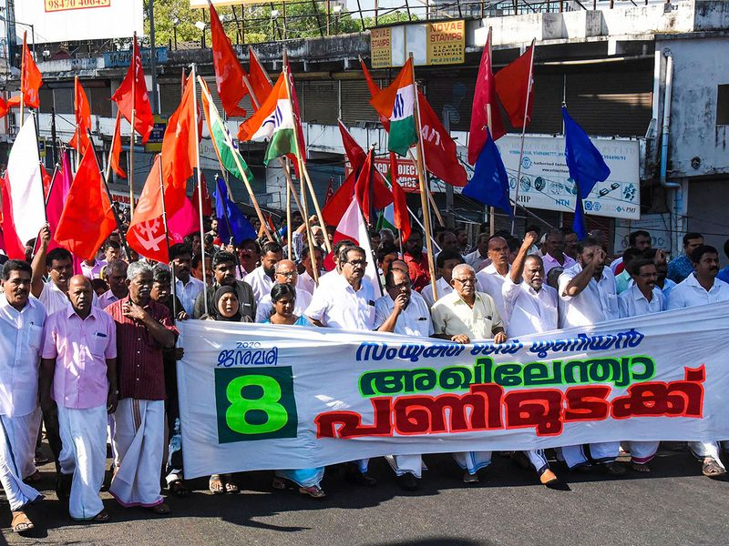 Members of various trade unions stage a rally during the trade unions' nationwide strike over various demands, in Kochi