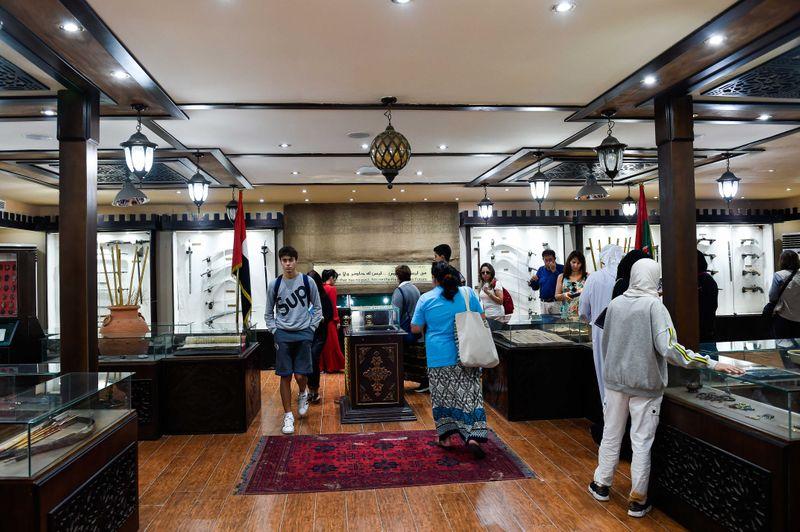 Visitors inside the Heritage Village Abu Dhabi.