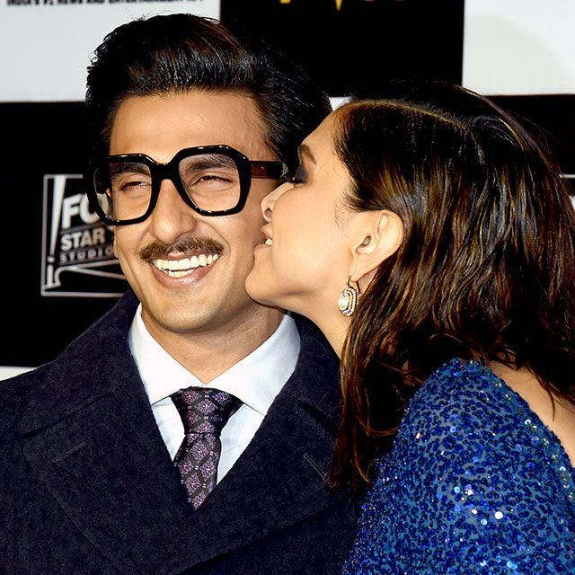 Deepika Padukone kisses husband Ranveer Singh