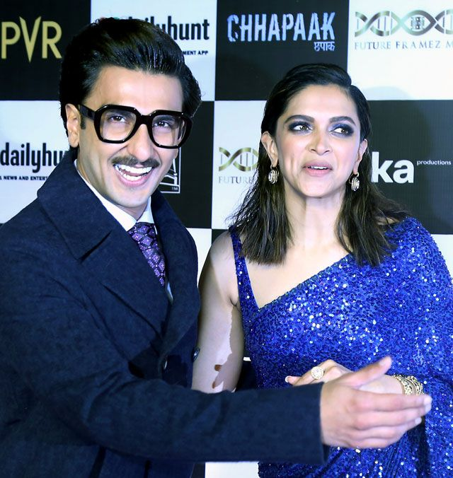 Deepika Padukone with husband Ranveer Singh during film 'Chhapaak' special screening at PVR Juhu in Mumbai. Deepika looked stunning in a glittering blue saree while Ranveer made a dapper appearance in a suit.