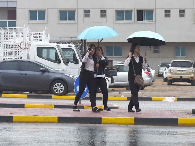 Residents with umbrella during rain in Ajman on 10 JAN 2020