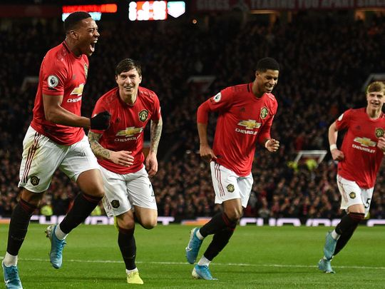 Manchester United's Anthony Martial celebrates scoring their third goal against Norwich City.