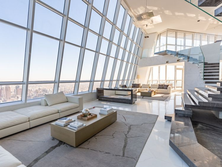 PW-200113_most expensive penthouse_The 20 feet high ceiling offers panoramic views of the ocean with an Armani Grey marble staircase-1578901152643