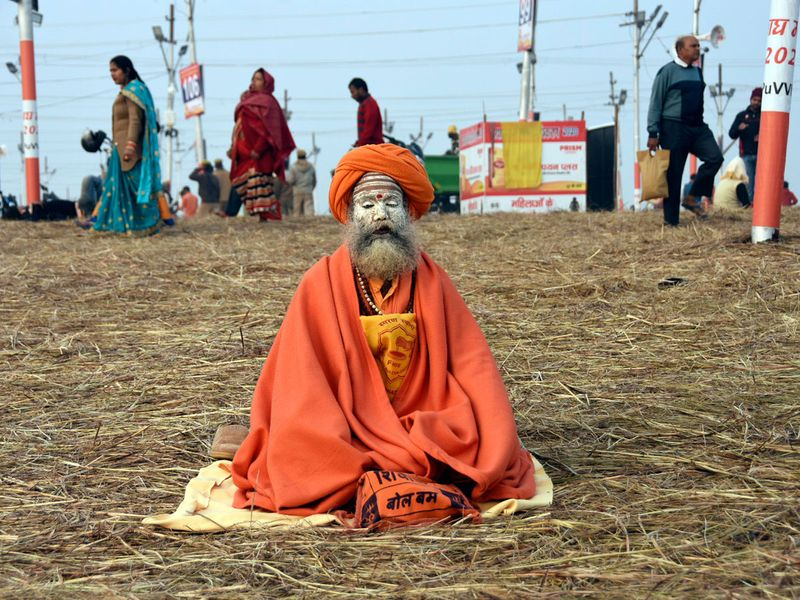 A Sadhu offers prayer at Sangam on the occasion of Makar Sankranti festival during ongoing Magh Mela 2020 in Prayagraj