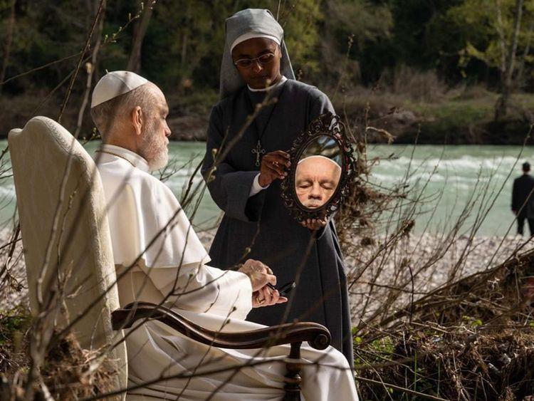 John Malkovich and Nadie Kammallaweera in The New Pope (2020)-1579066611808