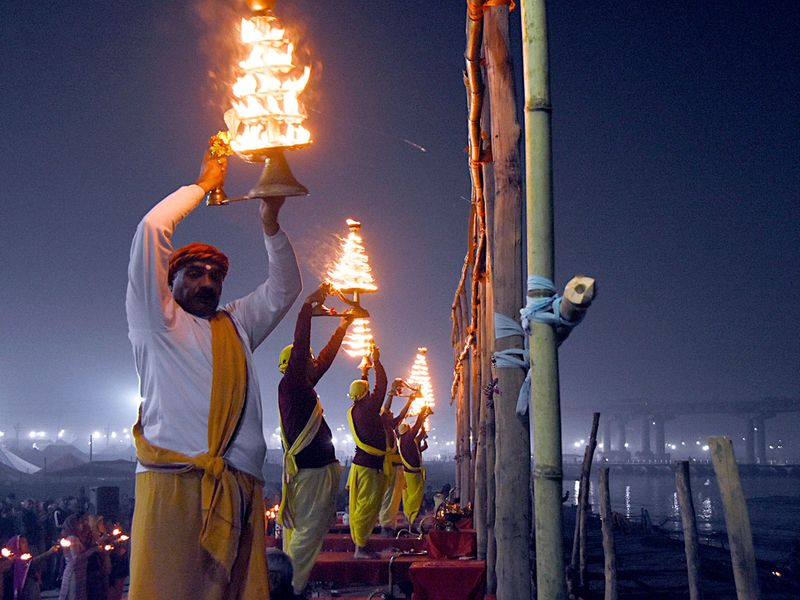 Priests perform Ganga Arti at Sangam on the occasion of Makar Sankranti festival during ongoing Magh Mela 2020 in Prayagraj