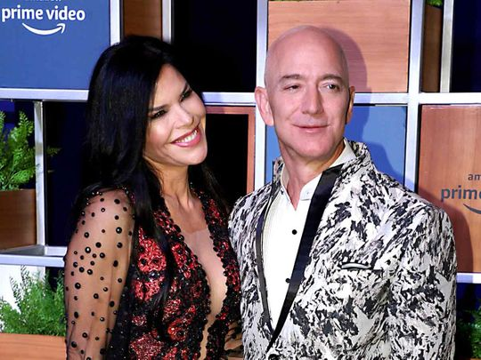 Amazon CEO Jeff Bezos along with his girlfriend arrives for a gathering with the Bollywood industry during his visit to Mumbai on Thursday.