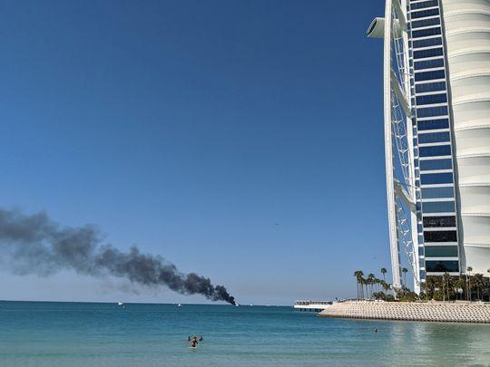 Fire put out on yacht Dubai's Burj Al Arab, three people rescued