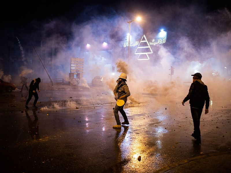 Demonstrators during a clash with security forces in Beirut, Lebanon.